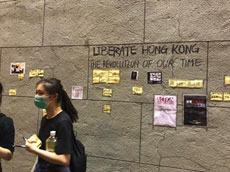 People leaving the civil servants rally start a Lennon Wall